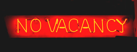 Red sign showing high occupancy at a hotel