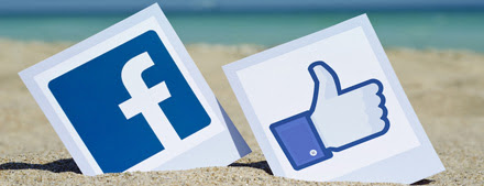 The facebook icon, on the beach outside a hotel